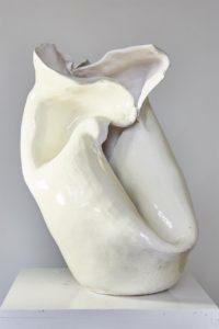 A white, curvaceous ceramic sculpture